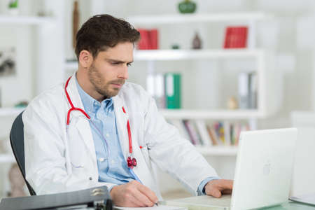 technology career: confident doctor at his office at clinic Stock Photo
