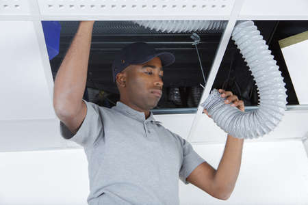 aeration: workman repairing aeration