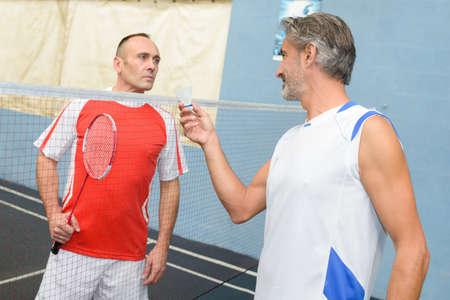 serf: men playing badminton Stock Photo