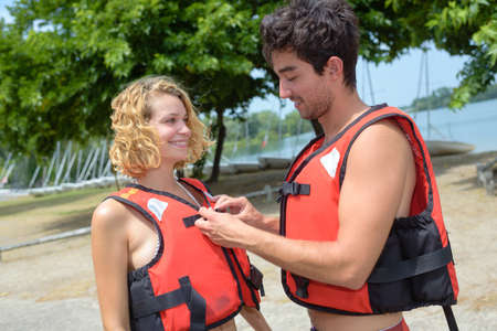 Man securing partners lifejacket
