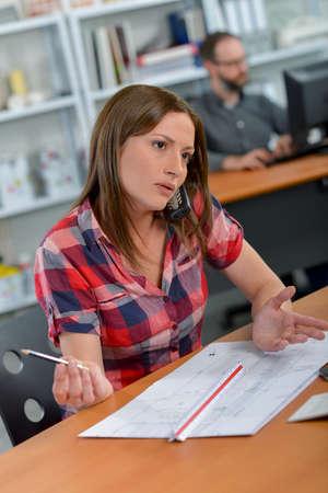 argumentation: Busy employee Stock Photo