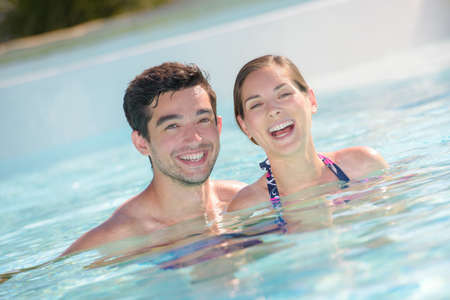 vacationer: happy vacationer in the swimming pool