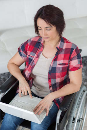 devastating: after devastating accident she works from home while recovering Stock Photo