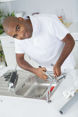 sealant: Plumber at work Stock Photo