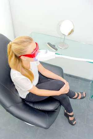 nonsurgical: lady having dental treatment, wearing protective glasses