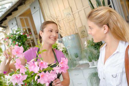 Florist enticing a customer