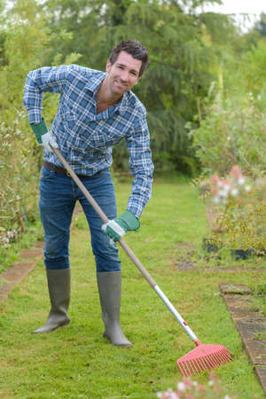Man raking lawn