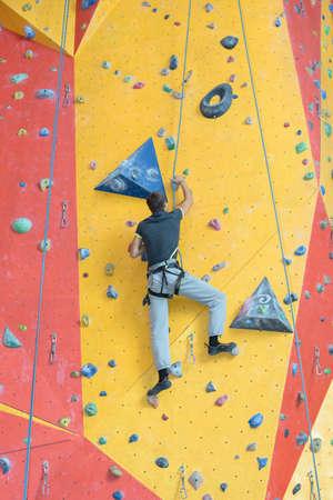crack climb: fun of wall climbing Stock Photo