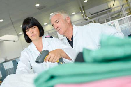 scaner: Woman using handheld scanner Stock Photo