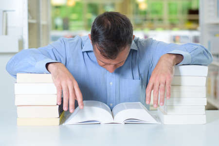 resourceful: using books for support Stock Photo