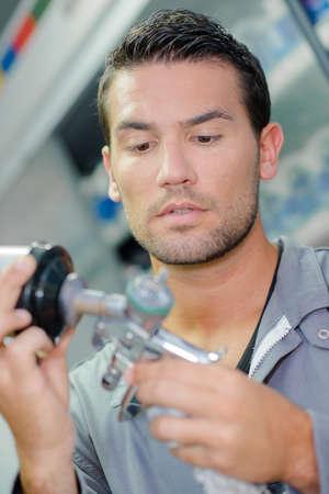 Mechanic holding part Stock Photo