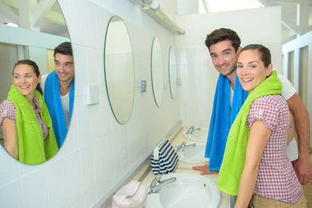 communal: Couple at communal sink