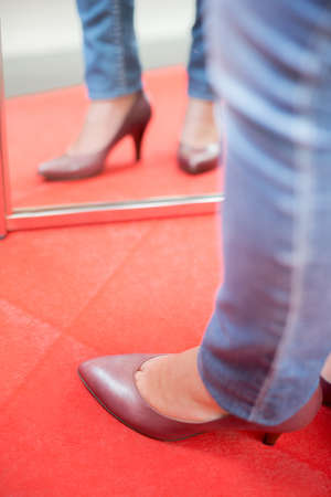reflectance: Trying on shoes in the mirror Stock Photo