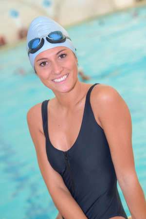 waterproof cape: swimmer posing next to the pool