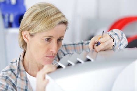 appliance: woman fixing an appliance