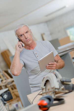 jobsite: workman on cellphone Stock Photo