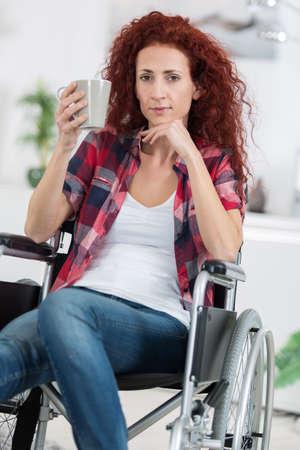 atractive: woman in wheelchair Stock Photo