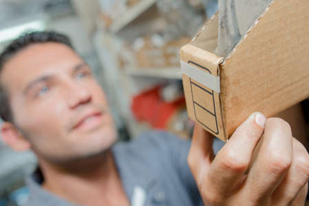 man holding a box Stock Photo