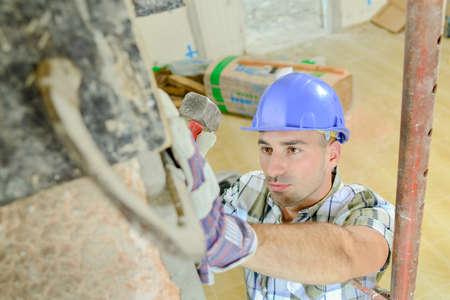 Looking down on working builder