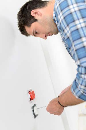 wall socket: Electrician fitting a socket Stock Photo