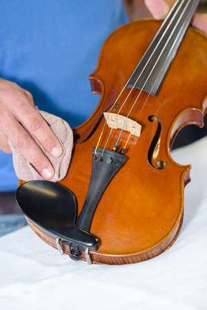 polishing the violin
