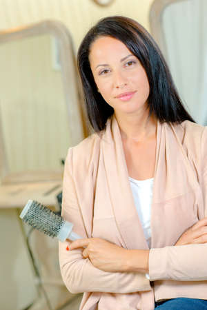 styler: woman with hairbrush