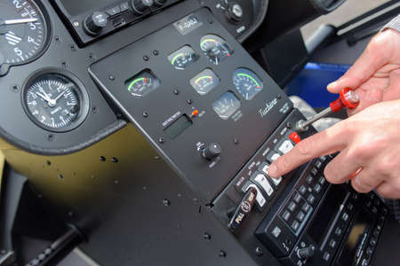 manipulating: Man manipulating controls in cockpit Stock Photo