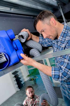 heat register: Installing new ventilation system Stock Photo