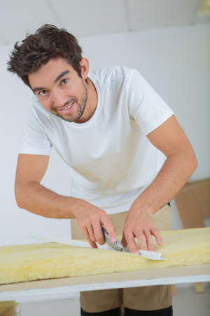 skillful: plasterer cutting a foam