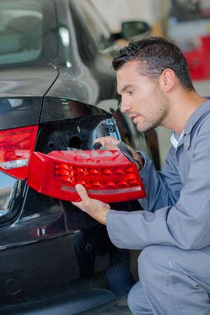 disengage: repairing parking light Stock Photo