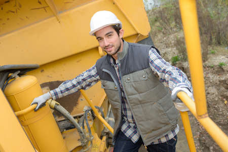 foremaster: Man stood on platform of plant machinery Stock Photo