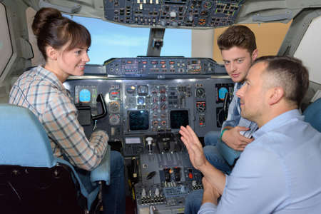 Young people in cockpit of aircraft