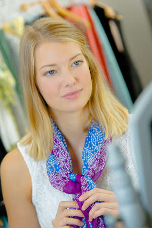woman putting a scarf on