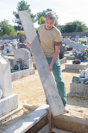 groundskeeper: preparing a tomb Stock Photo