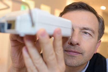 shortsighted: optician examines the eyesight of his pretty client Stock Photo