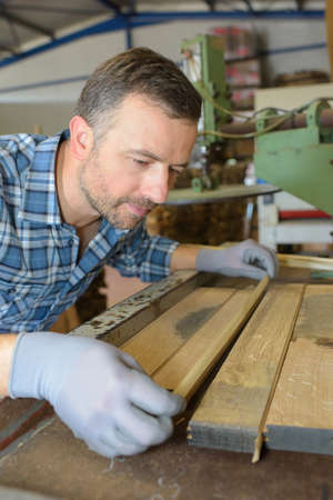 tongue and groove: Carpenter lining up tongue and groove Stock Photo