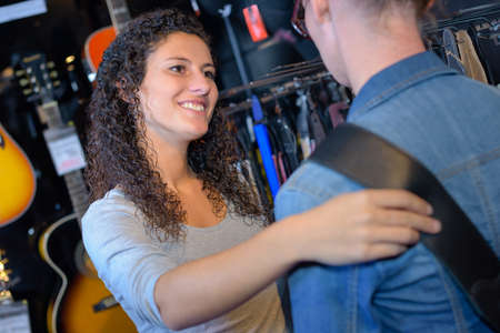 reassure: Lady holding womans shoulder in musical shop