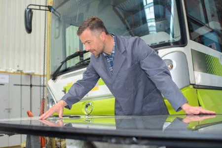 mechanician: Mechanic working on a bus
