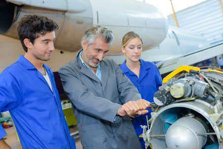 Man trying to lever part of aircraft engine