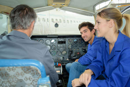 technical department: having a conversation in the cabin Stock Photo