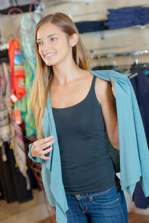 coathanger: Young woman in a clothes store