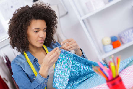 seamstress sews clothes workplace of tailor Stock Photo