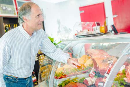 man choosing meat in butchers Stok Fotoğraf