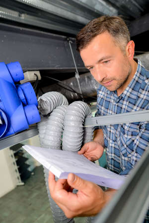 heat register: Man installing a new ventilation system