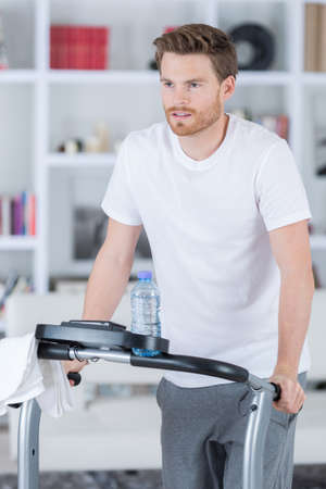 domiciles: content handsome man training on exercise bike