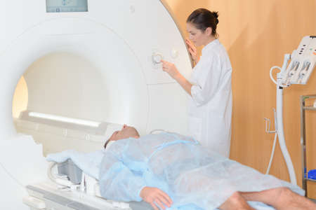 activating: Nurse activating mri scanner Stock Photo