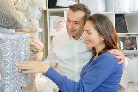 desire: Couple looking at home furnishings Stock Photo