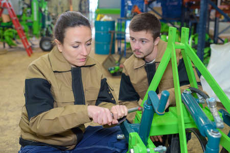 young mechanic and apprentice in a workshop