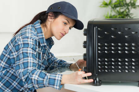 appliance: girl fixing appliance