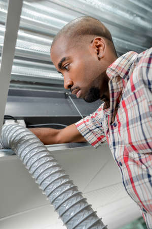 looker: holding the ventilation pipe Stock Photo